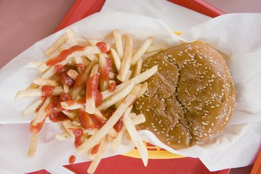Hamburger and french fries on a fast food tray