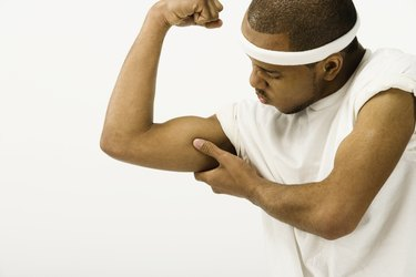 Studio shot of African man flexing biceps