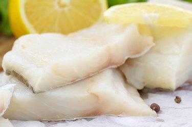Raw fish with vegetables, lemon and seasonings