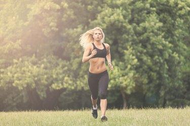 Beautiful female athlete running