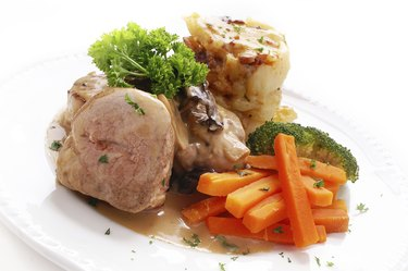 plated roast pork loin dinner with vegetables
