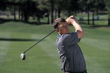 Man Swinging a Golf Club