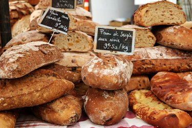 Fresh loaves of french bread on market stall in Provence