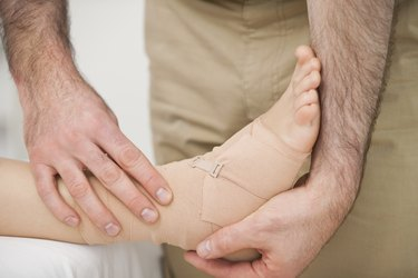 Foot being strapped by a doctor