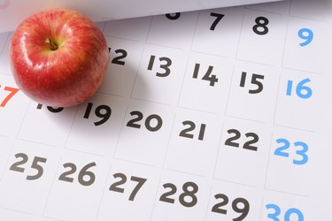Red apple on calendar