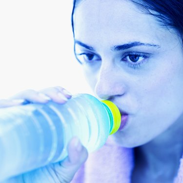 close-up of a woman drinking water