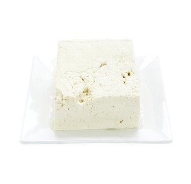 Tofu on plate on white background