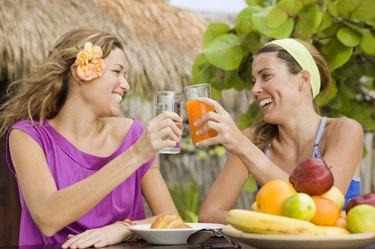 Women talking and having tropical fruit