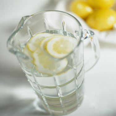Pitcher of Water Garnished with Lemon Slices