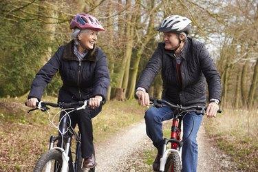 Senior couple with knee arthritis riding bikes