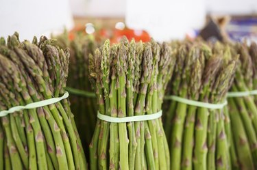 Raw fresh asparagus at the outdoor market