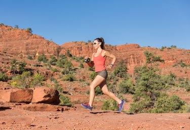 Woman Running Outdoors Uphill