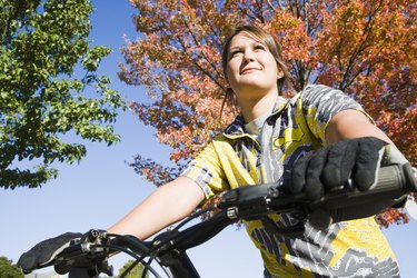Low angle view of a woman riding a mountain bike