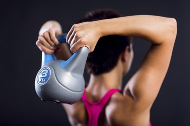 Fitness woman doing a weight training
