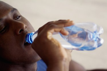 Man drinking bottled water, close-up