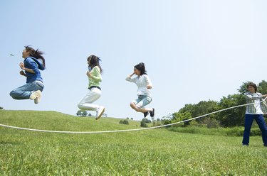 Four young people skipping