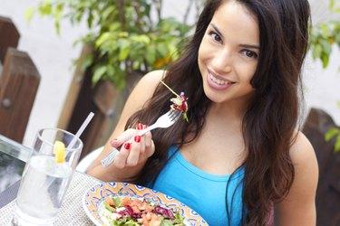 Young Beautiful Hispanic Woman Having Fresh Salad