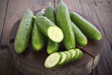Fresh cucumber on the wooden table