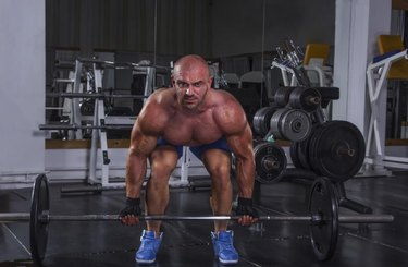 Exercise for back and legs in gym