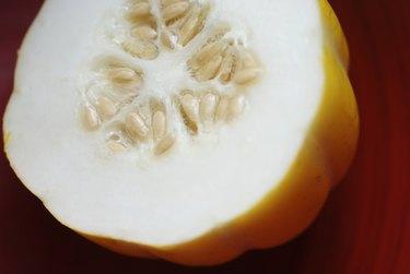 Close-up of a yellow Thai squash cut in half.