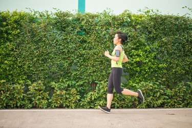 Asian woman running in the park healthy
