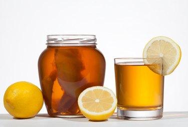 Kombucha super food pro biotic beverage in glass with lemon