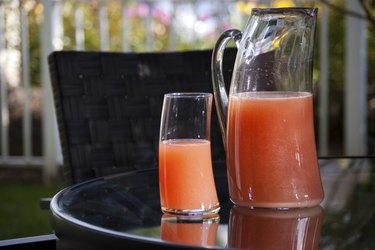 Cranberry Fizz Cocktail Drink in single glass and pitcher