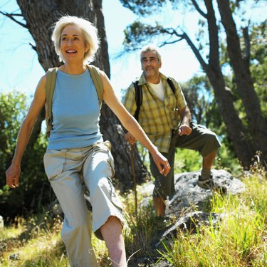 front view of mature man and mature woman walking in countryside