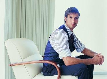 Portrait of a Stylish Businessman Sitting in an Armchair