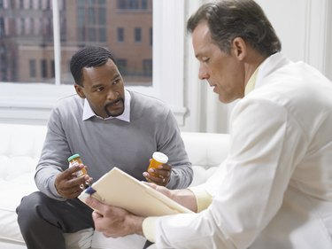Doctor Giving an Explanation About the Medicine Given to a Male Patient