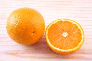 An orange and a orange half