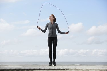 Healthy young woman with jump rope