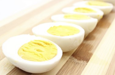Hard-boiled eggs left out on cutting board