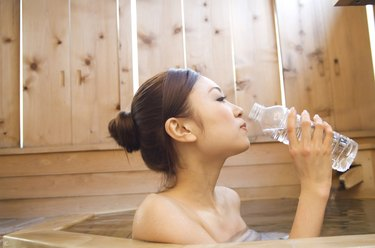 Woman drinking water in a hot tub