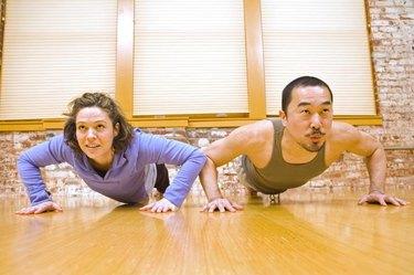 Man and Woman Doing Pushups