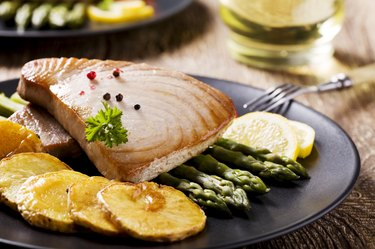 Grilled tuna steak served on asparagus with roasted zmieniakami