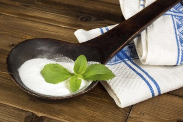 Old spoon with fresh stevia leaf