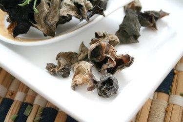 dried black fungus mushrooms on white plate