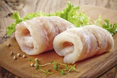 raw hake fish fillet rolls