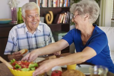 Senior couple eating delicious breakfast
