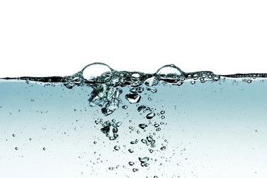 Splash of water,drops and bubbles on a white background.