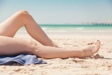Close Up Of Women's Legs On The Beach