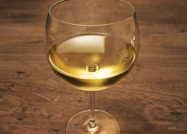 Glass of white wine on wood table