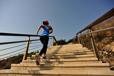 healthy lifestyle sports woman running up on stone stairs