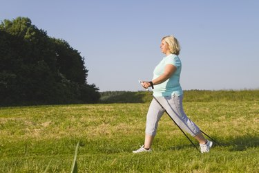 Mature woman hiking through field