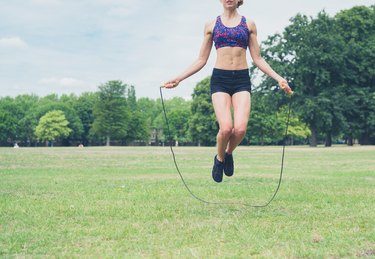 Young woman skipping in the park