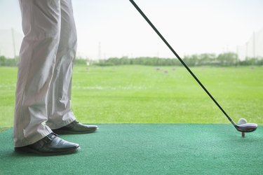 Man getting ready to hit a golf ball