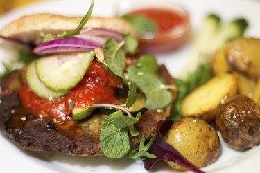 Delicious vegan burger on white plate