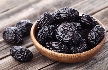 Prunes on a wooden background