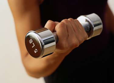 Close-up of a Woman Lifting a Dumbbell